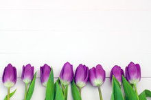 Lilac Tulips On A White Wooden...