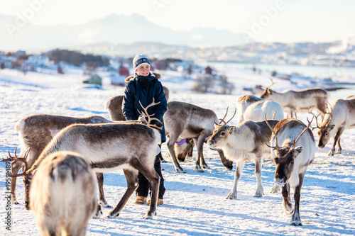 Teenage boy with reindeer