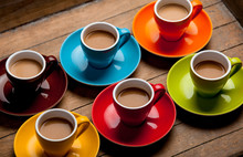 Six Colorful Cups Of Coffee