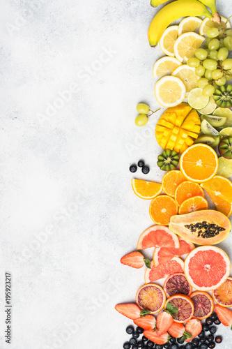 Raw fruits in rainbow colours, strawberries, mango, grapes, bananas, grapefruit Canvas Print