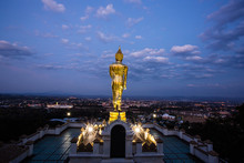 Buddha Standing On A Mountain At Wat Phra That Kao Noi With Sunrise. Nan, THAILAND.