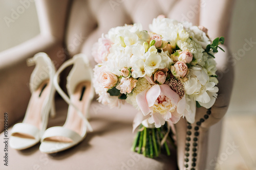 close-up of a wedding bouquet of white peonies, rose carnations which stands on Fototapet
