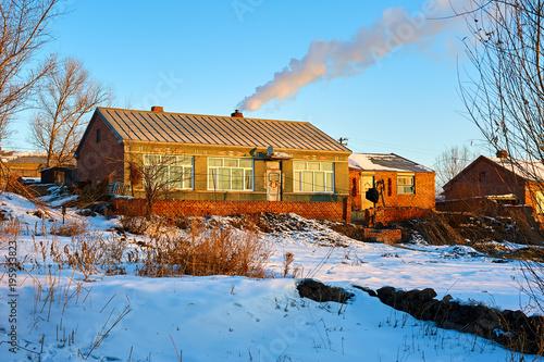 Vászonkép The village morning of winter.