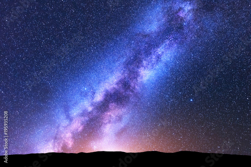 Montage in der Fensternische Dunkelblau Milky Way. Space. Scenic night landscape with bright milky way, sky full of stars, orange light and hills. Shiny stars. Beautiful scene with universe. Space background with starry sky. Concept. Nature