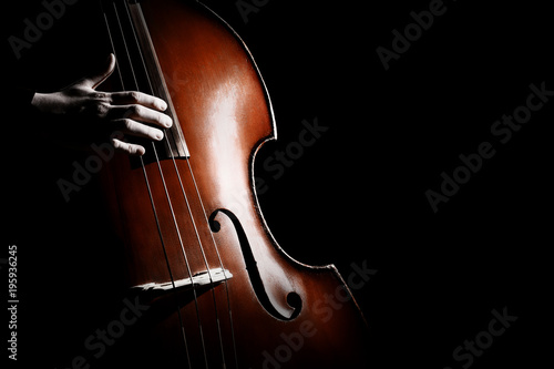 Foto auf Leinwand Musik Double bass. Hands playing contrabass player musical instrument