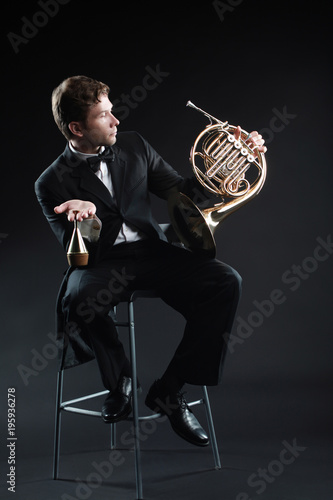 Fotoposter Muziek French horn player classical musician portrait