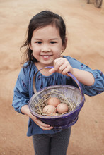 Cute Young Girl Holding Basket...