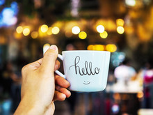 Hello Text Hand Writing On Cup With Hand Holding