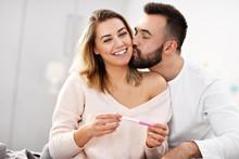 Happy Couple With Pregnancy Te...