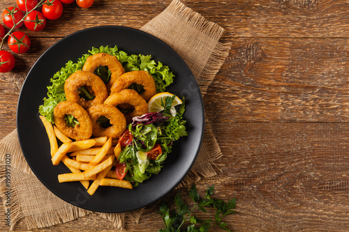 Roasted squid rings with fries