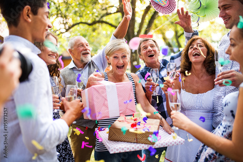 Obraz Family celebration or a garden party outside in the backyard. - fototapety do salonu