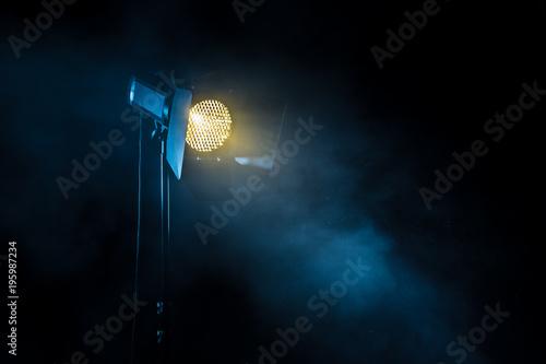 Photo  Theater spot light on black background.