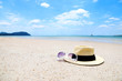 Panama hats and sunglasses On the beach Copy space