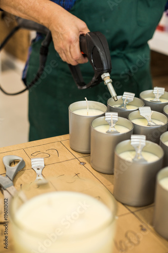 Closeup Of Hands Heating Candle Wicks Of Homemade Candles Buy This Stock Photo And Explore Similar Images At Adobe Stock Adobe Stock