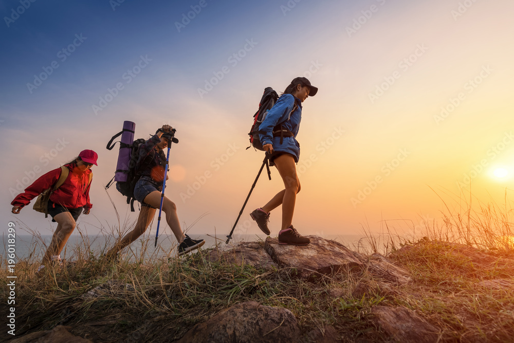 Fototapety, obrazy: Lady hikers walking in the mountains.