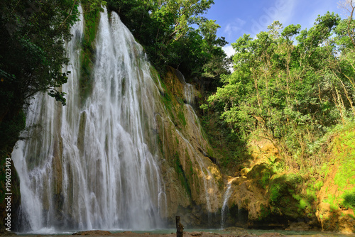 Fotobehang Watervallen Salto de Limon the waterfall located in the centre of the tropical forest, Samana, Dominikana Republic.