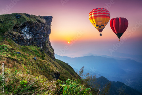 Foto op Plexiglas Ballon Colorful hot air balloons flying over mountain at Phu Chi fa National Park in the morning. Chiang Rai Province, Thailand