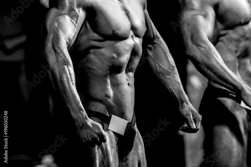 Fototapeta man athletes bodybuilders in relaxed poses  bodybuilding competition obraz