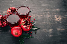 Fresh Pomegranate Juice. Pomegranate. On A Black Wooden Background. Top View. Copy Space.
