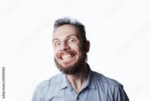 Valokuva  expression and people concept - man with funny face over white background