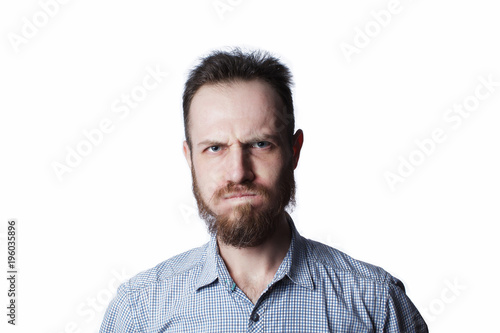 Fototapeta  Face of an angry and furious male on a white background.
