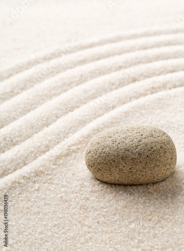 Tuinposter Stenen in het Zand Zen sand and stone garden with raked curved lines. Simplicity, concentration or calmness abstract concept