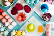 Dyeing Eggs For Easter Holidays, Coloring With Different Red  Color And Tonality Using Food Colorant Over A Gray Concrete Background