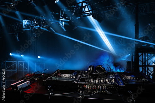 DJ console in the atmosphere of the party, light spotlights Fototapet