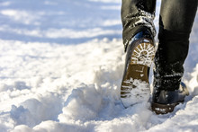 Woman Walking In Snow Boots An...