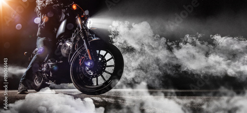 Deurstickers Fiets Close-up of high power motorcycle chopper with man rider at night
