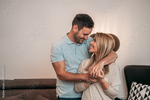Happy couple hugging while looking at each other. Canvas Print