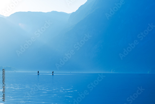 Foto op Canvas Purper Stand up paddle boarding on lake Bohinj