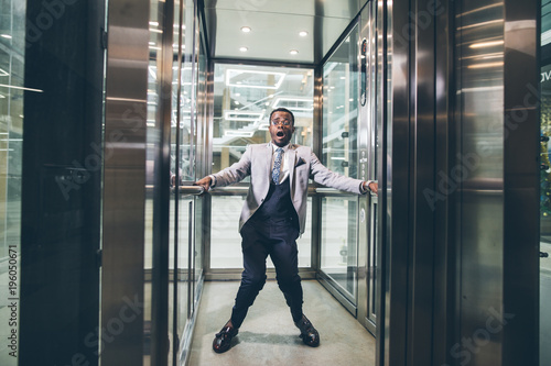 african Businessman screaming in the elevator Canvas Print
