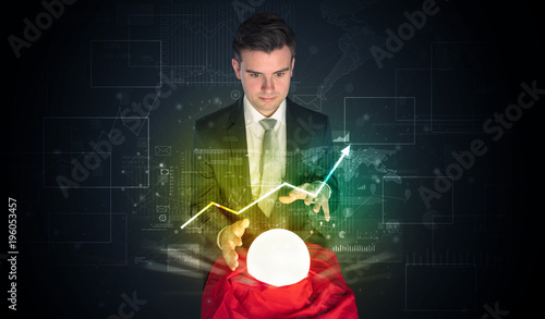 Cuadros en Lienzo Businessman forecast the future of the stock market with a magic ball