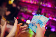 girl holds 5 new 2000 rubles and pays for a cocktail in the club restaurant
