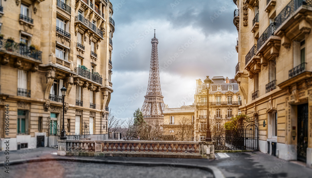 The eiffel tower in Paris from a tiny street