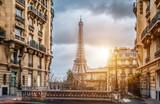 Fototapeta Paryż - The eifel tower in Paris from a tiny street