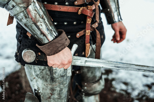 Fotomural man's hand with an iron sword