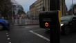 Pedestrian presses the crossing button in able to cross the street. Tilt close up.