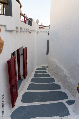 Stairs in the narrow streets in Chora of Amorgos with a window at the left Wallpaper Mural