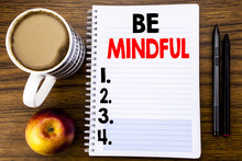 Handwritten Text Showing Be Mindful. Business Concept For Mindfulness Healthy Spirit Written On Notepad Note Paper On The Wood Structure Background Background.