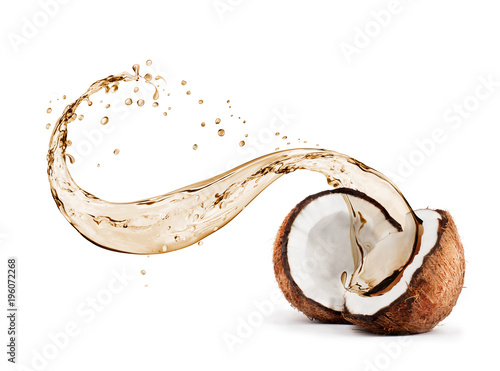 Coconut with splashes of juice close-up, isolated on white background