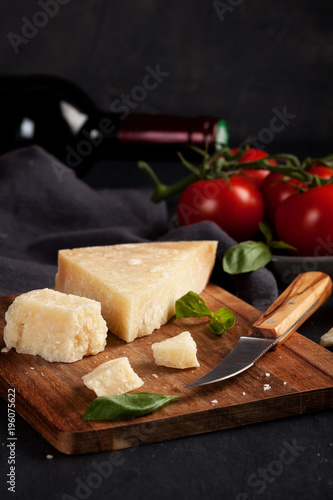 Traditional ingridients of italian cuisine: parmesan cheese, tomatoes, basil, olive oil, red wine