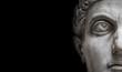 Leinwanddruck Bild - Statue of Roman Nobel Man  isolated at black background, Rome, Italy