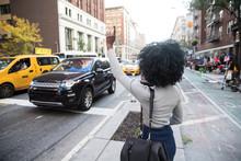 Woman Hailing A Taxi Cab On A ...