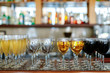 glasses of champagne, white wine and red wine bottle background on the bar table