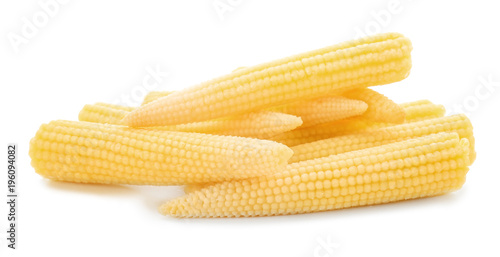 Heap of fresh young baby corn on white background