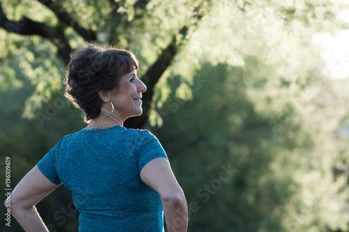 Fotografie, Obraz  Active Woman Backlit by Sun on Hiking Trail
