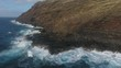 View Rugged Hawaii Coastline With Swimmers and Big Waves