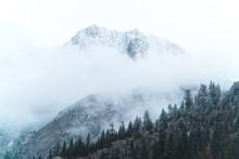 Some Moody Clouds Fog The Peak...